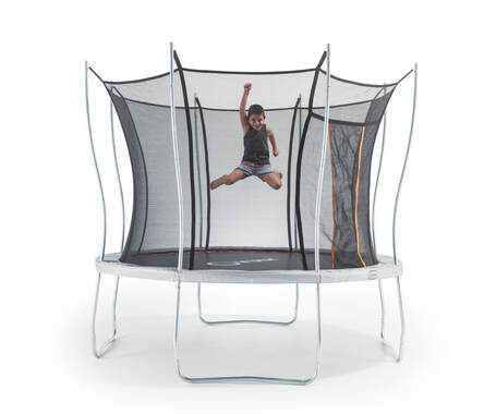 Young boy jumping on large Vuly Play trampoline